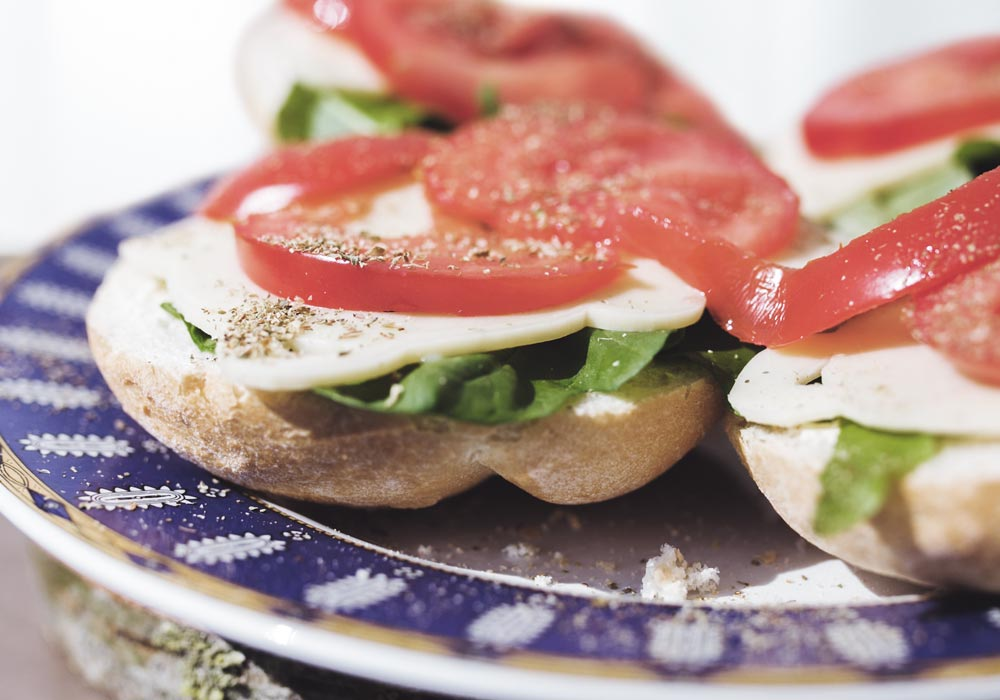 Bruschetta is an antipasto from Italy consisting  				of grilled bread rubbed with garlic and topped with olive oil and  				salt. Variations may include toppings of tomato, vegetables, beans,  				cured meat, or cheese.