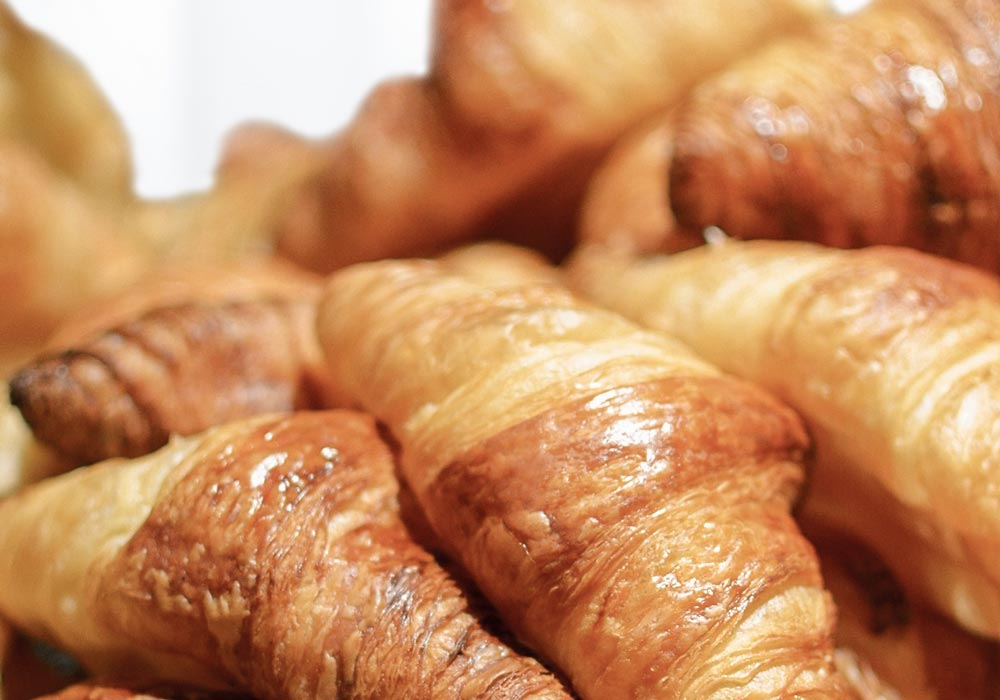 A croissant is a buttery, flaky, viennoiserie-pastry  				named for its well-known crescent shape. Croissants and other viennoiserie  				are made of a layered yeast-leavened dough.